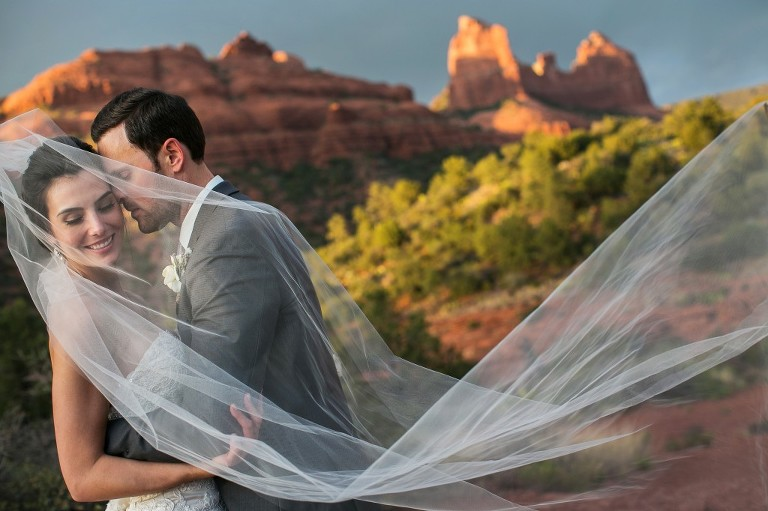 Sedona bride and groom in front of red rocks