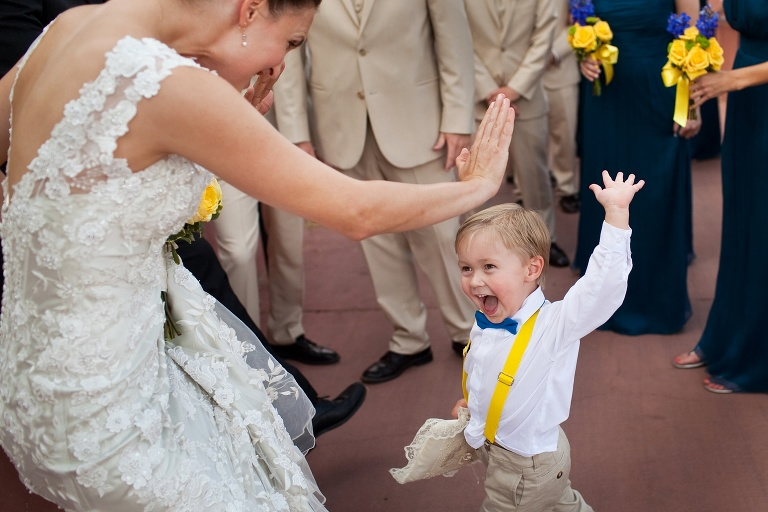 A boy giving a bride a high five at a wedding at L'Auberge de Sedona